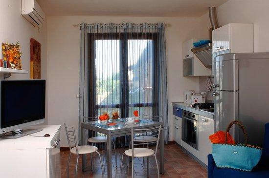 Cucina soggiorno - Bild von Residenza Principina, Principina Terra ...