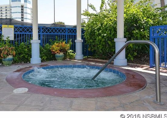 Covered hot tub area at clubhouse 1