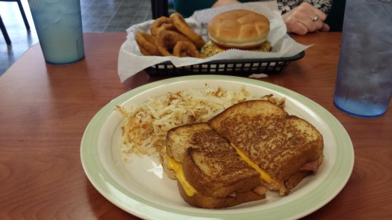 Martinsville, IN: Grilled cheese & hash browns; grilled tenderloin w/ onion rings in background.
