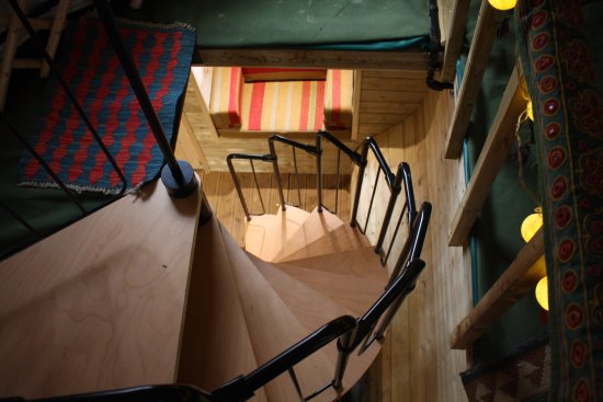 Abergele, UK: Spiral staircase, looking down from the main yurt.