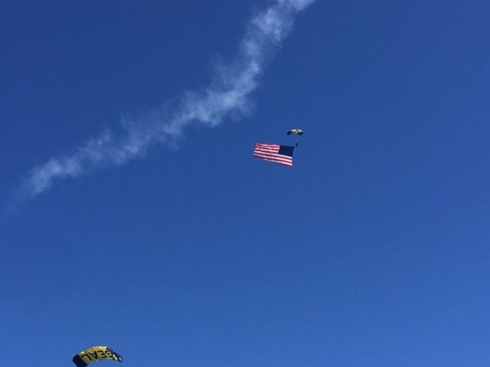 Pensacola Naval Air Station: Navy Seals parachuting in with the flag (sky writing planes flying around their decent).