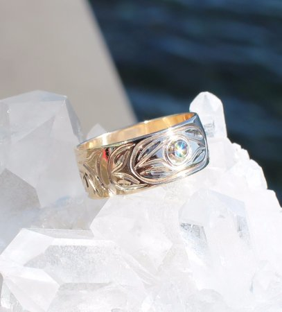 Campbell River, Canada: Mowisaht Designs Jewelry on-site. 14k gold ring set with a diamond and engraved with Thunderbird