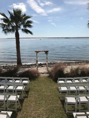 The Cottages on Charleston Harbor: View of our ceremony from cottage 2 facing out the screened in back porch