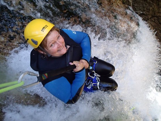 Motueka, Nowa Zelandia: The smile before being lowered down through a waterfall, what an amazing adventure