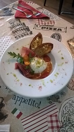 Sowerby Bridge, UK: BURRATA in a bed of crushed cherry tomatoes and prosciutto di Parma boun appetito!!!