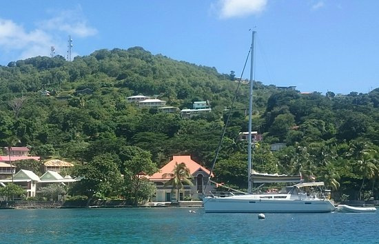 Port Elizabeth, Bequia: Gingerbread Hotel on the Bequia waterfront walkway in the foreground.