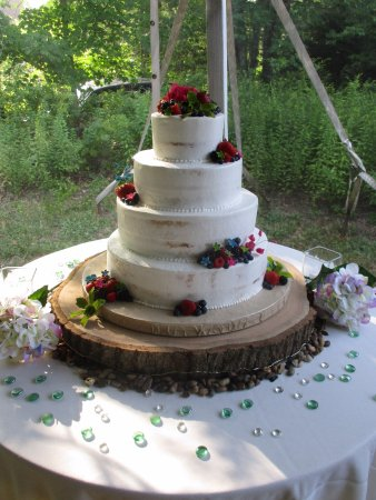 Rustic semi-naked wedding cake with fresh fruit and sugar flowers ...