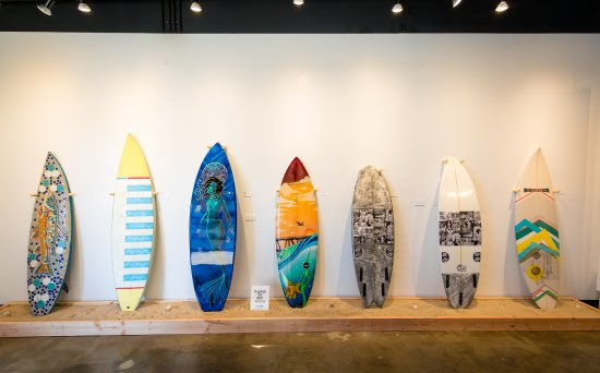 Resin Art and Photography Gallery: The gallery has an on-going program of artists painting surfboards that are ride-able and for sa