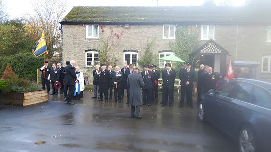 Herefordshire, UK: Royal British Legion marching from The Bells Inn, Almeley