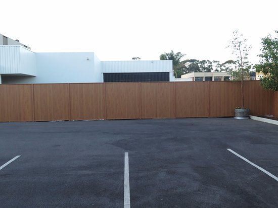 Griffith, Australia: Motel car parking area showing barrier between refurbished motel units and old style hotel area.