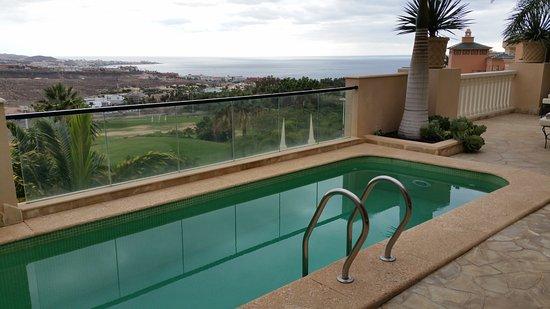 Royal Garden Villas: Pool and view