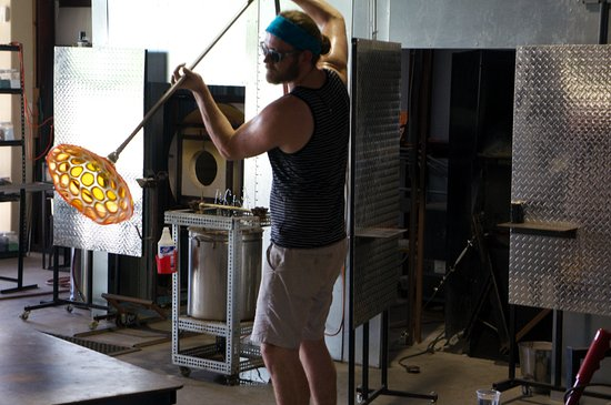 Tomball, TX: One of our glass makers spinning out a murine rondel.