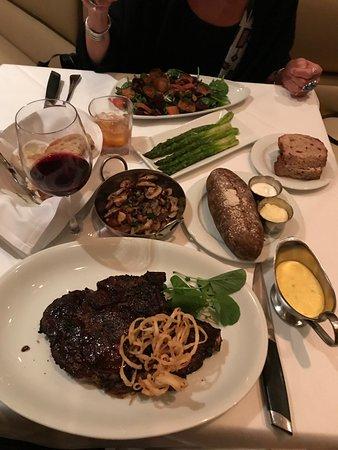 Gallagher's Steakhouse: Cowboy Ribeye, asparagus, baked potato, mushroom medley and wine