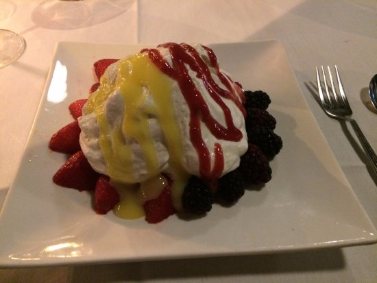 Parker's Bistro: pavalona (sp) - baked meringue, whipped cream, fresh strawberries, blackberries, raspberries
