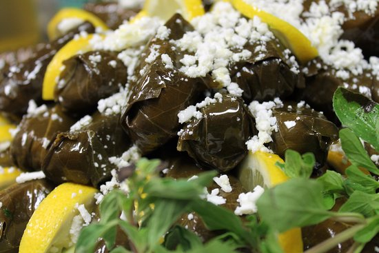Rowlett, TX: Dolmathakia:  Rice, Mint, Lemon Juice wrapped in Grape leaves.