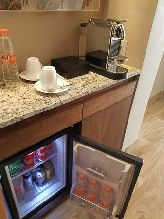 Nice Mini Fridge Cabinet On Other Side Is Storage Picture Of - Mini fridge side table