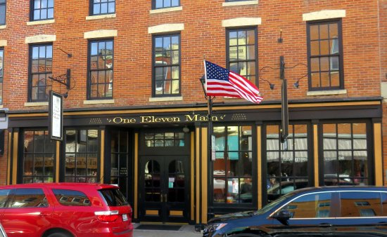 front of & entrance to One Eleven Main on Main St.