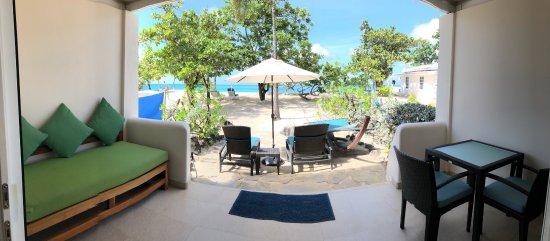 Spice Island Beach Resort: Grande Anse Beach, Private Patio with Sea view, inside Seagrape Suite