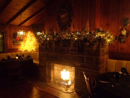 Maitre D At Trombino's: Cozy, fireside dining.