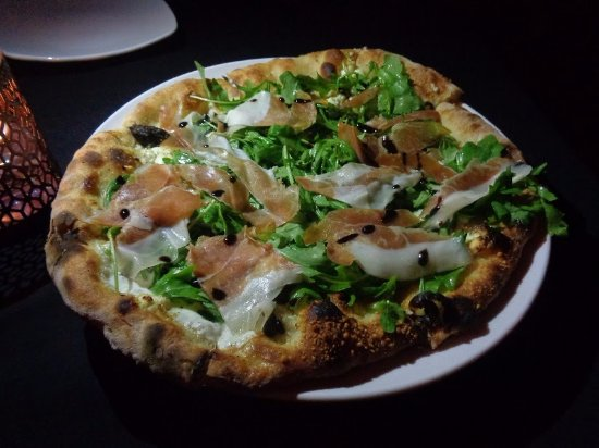 Maitre D At Trombino's: Fig Prosciutto Pizza: arugula, goat cheese, fig balsamic and fresh mozzarella..
