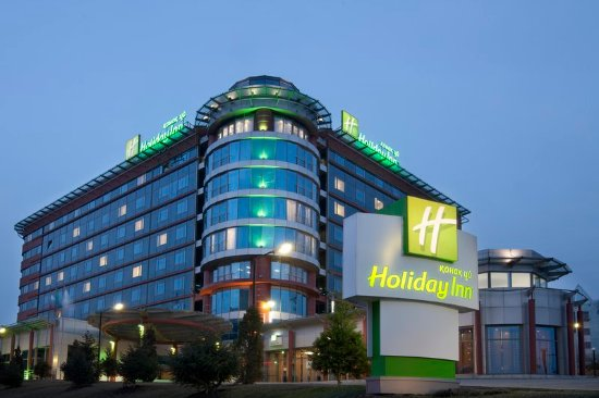 Holiday Inn Almaty Hotel exterior by night