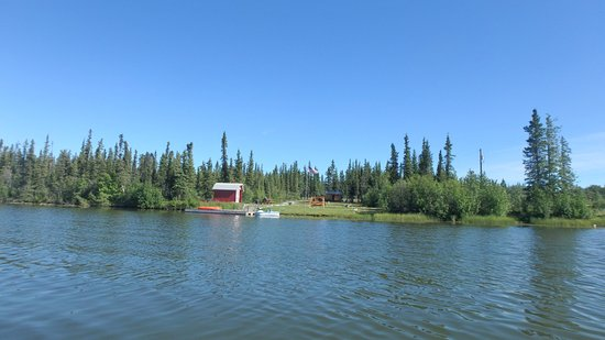 Pippin Lake Bed and Breakfast: The cabin and boathouse from a boat on the lake.