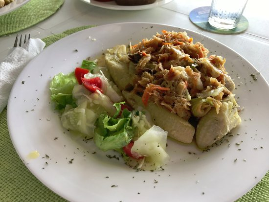 """Reduit Beach: An excellen""""Saltfish with green figs"""", served in the Yacht. Green figs are actually green banana"""