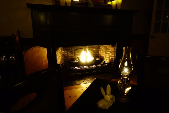 Saint Johnsbury, VT: Dining room fireplace from our table.