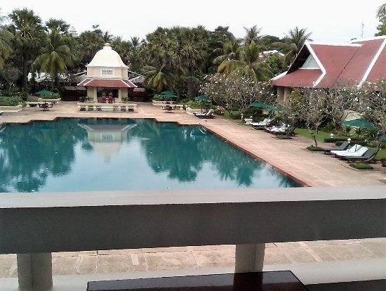 Raffles Grand Hotel d'Angkor: View of pool from balcony