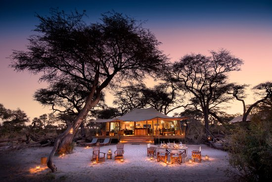 Somalisa Expeditions- African Bush C&s The main tented area and the boma area & The main tented area and the boma area for dining out under the ...