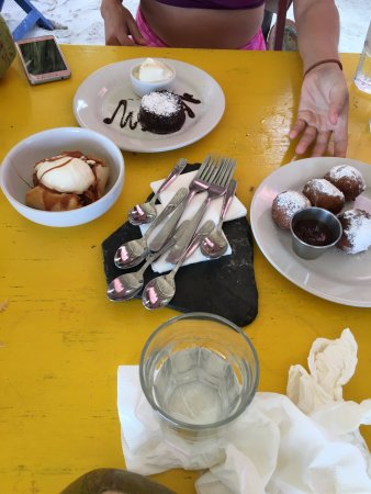 The Restaurant at ZAMAS: Left Banana Dessert, middle lava cake, right doughnuts w chocolate sauce
