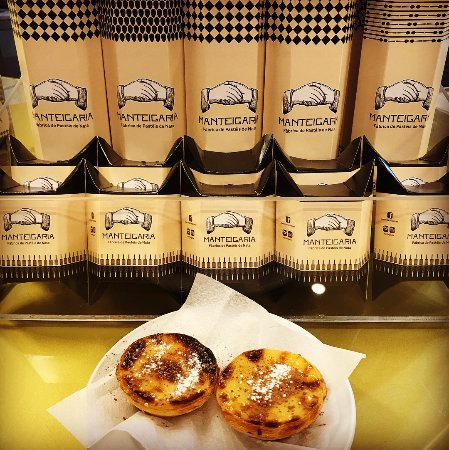 Freshly baked Pasteis de Nata sprinkled with some cinnamon and powder sugar!