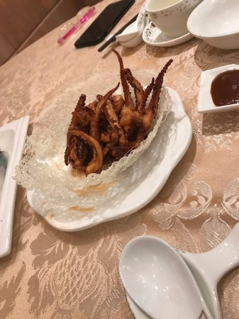 Crispy Fried Squid Tentacles dusted in spice mix With two dipping sauces