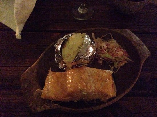 Arctic SnowHotel & Glass Igloos: Open fired cooked salmon with jacket potato and coleslaw - served on a traditional wooden plate