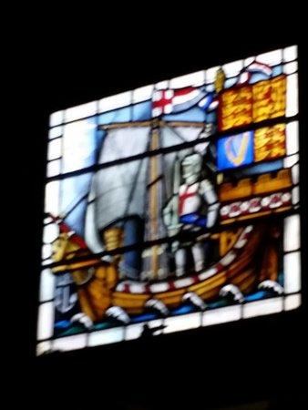 The Royal Standard of England: One of the stained glass windows inside