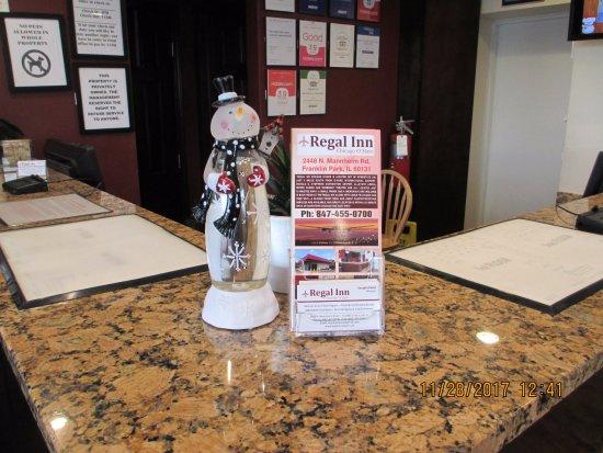 Franklin Park, IL: Festive snowman with our Regal Inn brochure