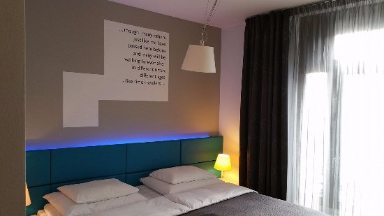 MOODs Boutique Hotel: Photo of the room. The blue light behind the headrest has dials to alter the colour & intensity