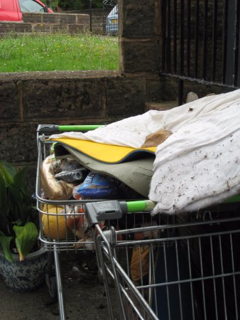 Seaton, UK: Dumped supermarket trolleys, sleeping bag and decaying food left by homeless people at council f