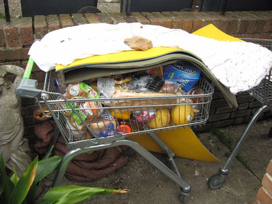 Seaton, UK: Dumped supermarket trolleys,sleeping bag and decaying food left by homeless people at council fl