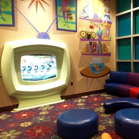 Disney's Pop Century Resort: Kids waiting area with cartoons