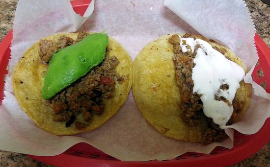 Mariachi's Tacos: ground beef tacos - one with avocado & one with sour cream