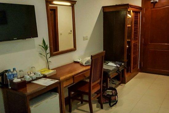 Kouprey Hotel: tv, fridge, storage area.