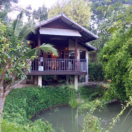 Our lovely cottage. Also, exploring the nearby temples and rice fields using the resort's mounta