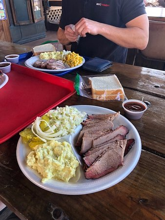 Cedar Creek, TX: smoked brisket with cole slaw and potato saled. other plate has the spicey corn salad.