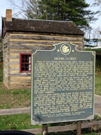 Galena, IL: information plaque by log house along U.S. Highway 20 & parking area
