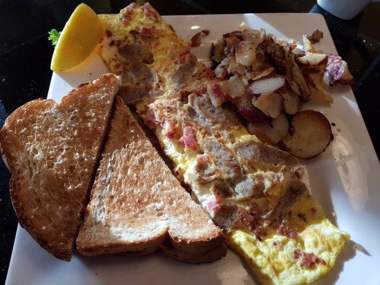 omelette mit dreierlei fleisch wurst schinken bacon foto keke 39 s breakfast cafe orlando. Black Bedroom Furniture Sets. Home Design Ideas