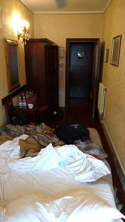 Hotel Galleria: View of six foot wide room - standing by the window (facing doorway)