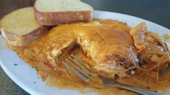 Vince's Restaurant & Pizzeria: Combo Lasagna with layers of meat, ricotta, and topped with alfredo and marinara sauce