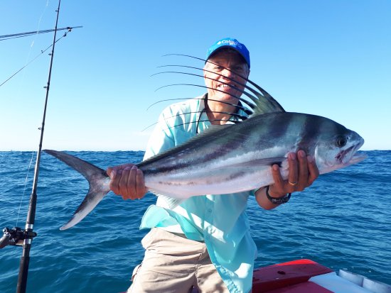 Miss capturing her first dorado picture of cabo mahi for Cabo san lucas fishing charters prices