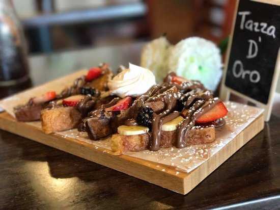Guayama, Puerto Rico: Our French Toast with fruits & nutella in Brioche Bread